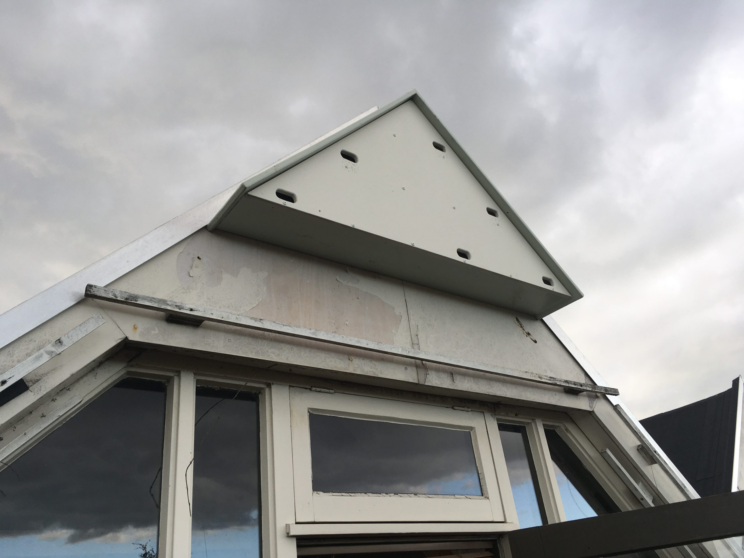 Roof renovations with reused Trespa.